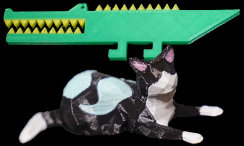 A 3D-printed cat and alligator.